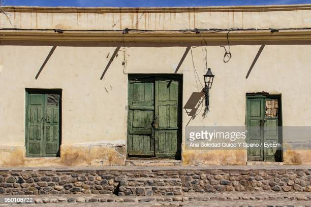 closed door of abandoned house - salta argentina stock photos and pictures