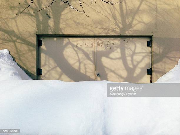 Closed Door Of Building Covered With Snow
