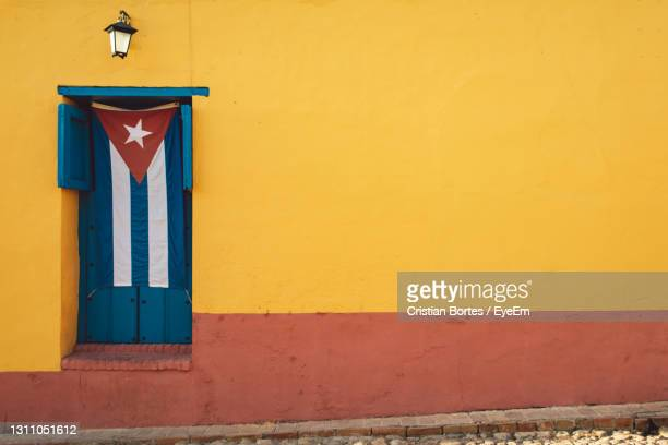 closed door of building with a flag - bortes stock pictures, royalty-free photos & images
