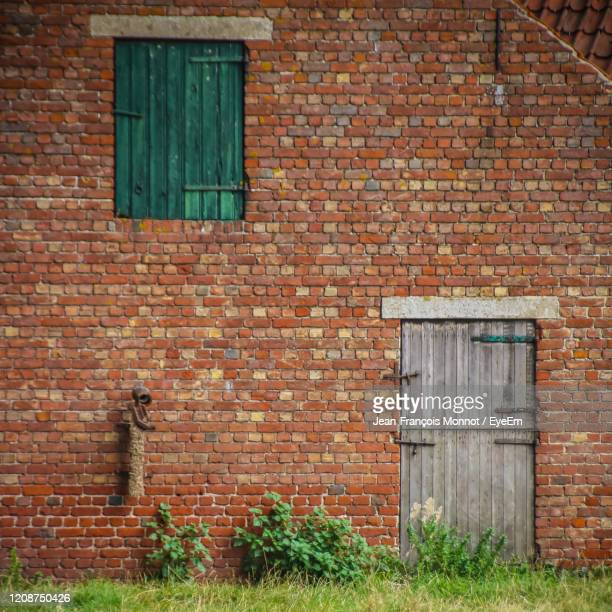 closed door of flemish building - damme stock pictures, royalty-free photos & images