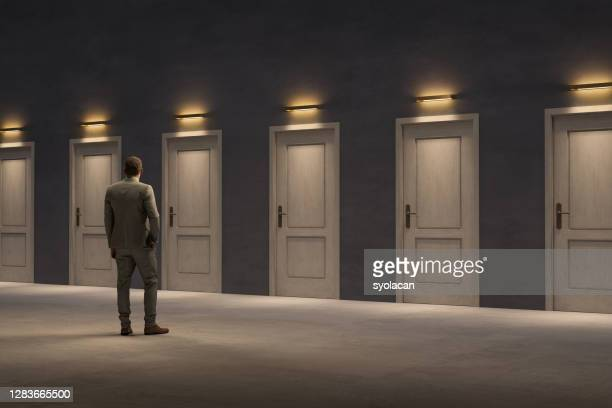 closed doors, too many options - one man only stock pictures, royalty-free photos & images