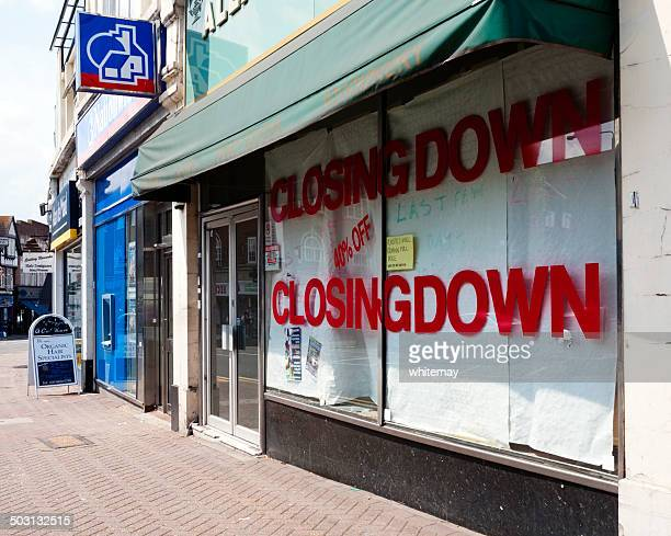 closed down high street shop - business closing stock photos and pictures