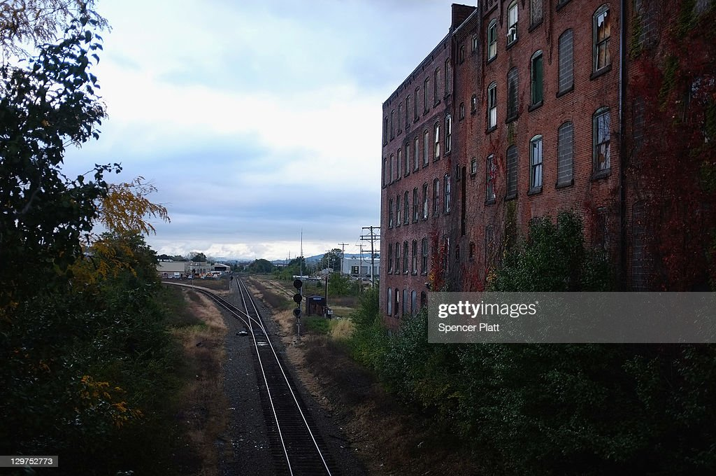 A closed factory is seen next to the railroad on October 20, 2011 in Reading, Pennsylvania. Reading, a city that once boasted numerous industries and the nation's largest railroad company, has recently been named America's poorest city with residents over 65,000. According to new census data, 41.3 percent of people live below the poverty line in Reading. Reading has about 90,000 residents, many of whom are recent Hispanic arrivals who have moved from larger eastern cities over the past decade. While a manufacturing base offering well paying jobs still exists in Reading, many companies like Hershey, Stanley Tool and Dana Systems have either moved elsewhere in the United States or to Mexico in search of cheaper labor. The number of people living in poverty in America, 46.2 million, is now at its highest level for the 52 years the Census Bureau has been keeping records.