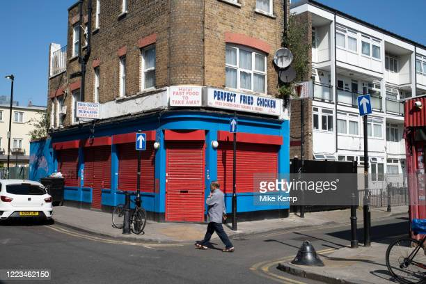 Closed fast food fried chicken takeaway shop in Shadwell on the day that it was announced that the Coronavirus lockdown measures are set to ease even...