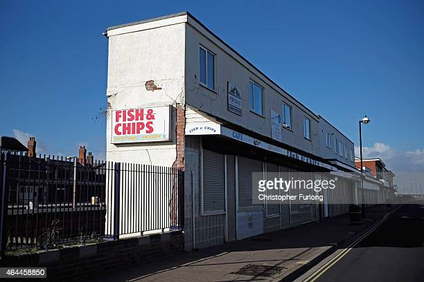 Closed for the Winter season a shuttered cafe on the promenade of Cleethorpes Greater Grimsby is famed for it's fishing and sea industries and is...