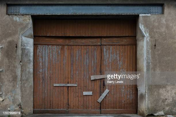 Closed garage doorway on 1st January 2010 in Carcasonne France The doors are fixed by screwed wooden planks as a rudimentary security measure