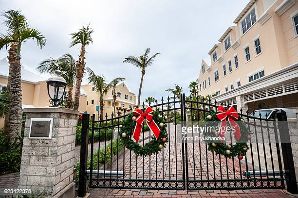 Closed gate to private residences with Xmas decorations, Bermuda