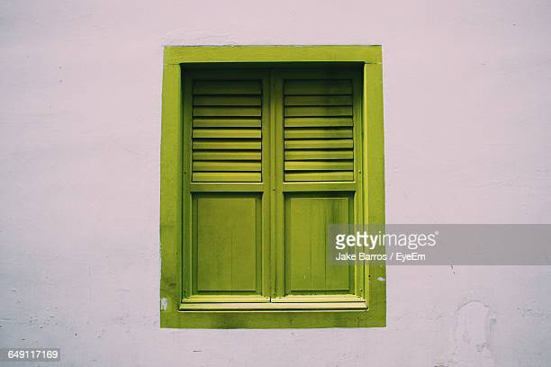 Closed Green Window On Wall