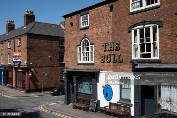 Closed gun shops and the Old Bell pub in the Gun Quarter, or Gunmakers Quarter as the Coronavirus lockdown continues, the city centre is still very...