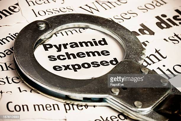 closed handcuff on headline: pyramid scheme exposed - ponzi scheme stock pictures, royalty-free photos & images