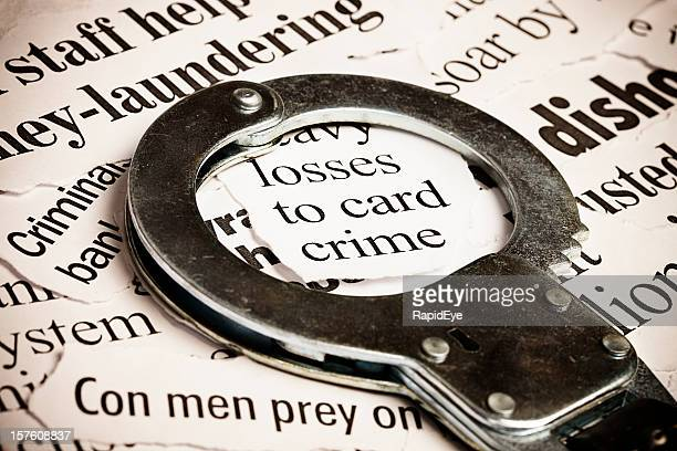 closed handcuffs frame a headline on credit card crime - ponzi scheme stock pictures, royalty-free photos & images