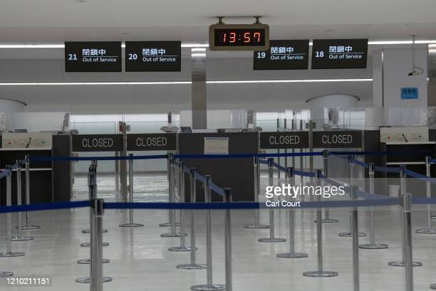 Closed immigration checkpoints are pictured at Narita Airport on April 17, 2020 in Tokyo, Japan. Narita Airport, one of Japans busiest, has closed...