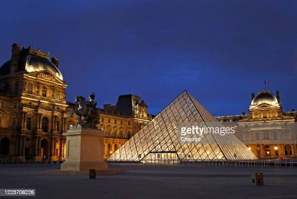 Closed Louvre pyramid and Louvre museum are seen at night as the lockout continues due to the epidemic of coronavirus on May 08, 2020 in Paris,...