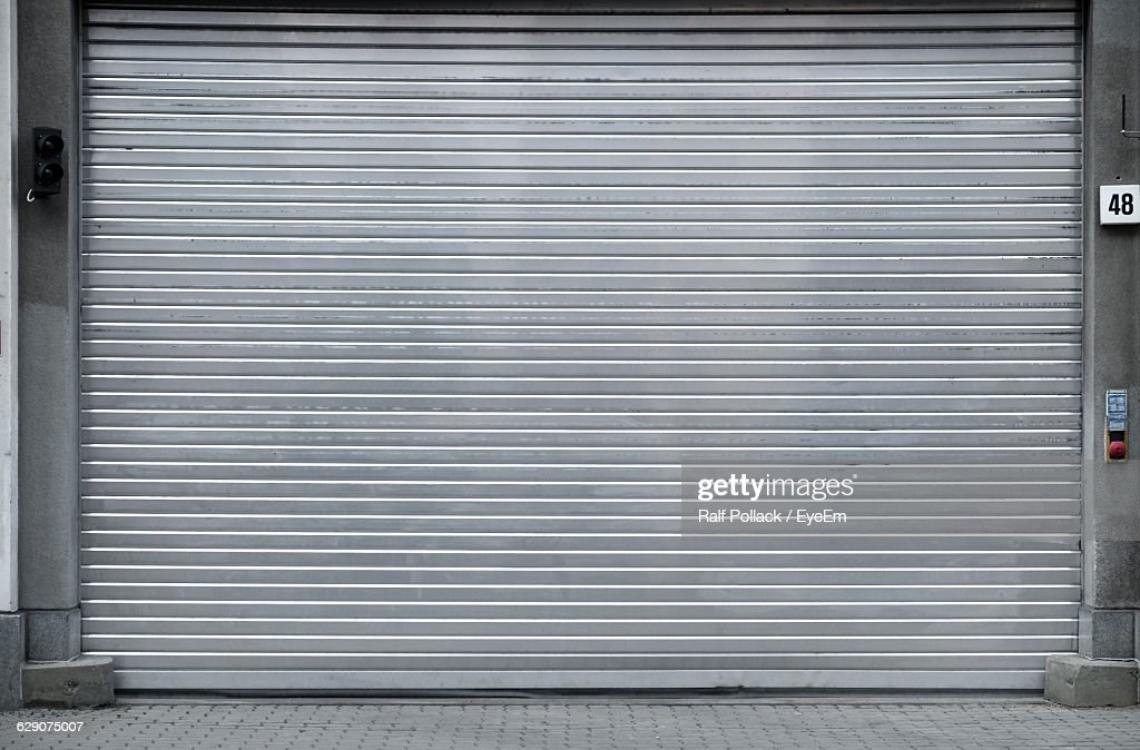 Closed Metal Shutter By Street : Stock Photo