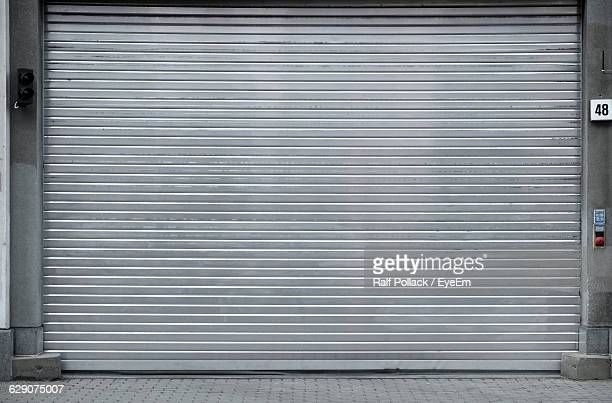 closed metal shutter by street - shutter stock pictures, royalty-free photos & images