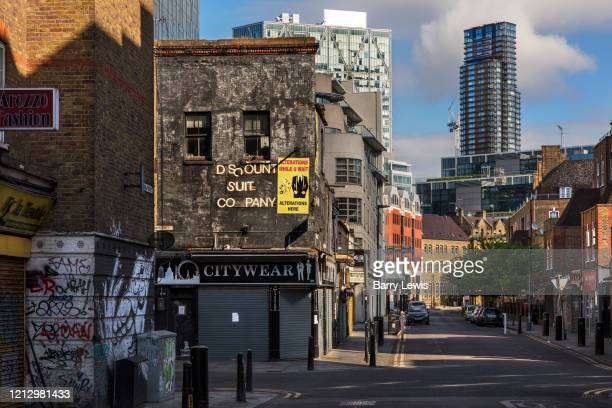 A closed Petticoat Lane market overlooked by City of London skyline during the coronavirus pandemic on the 2nd May 2020 in London United Kingdom