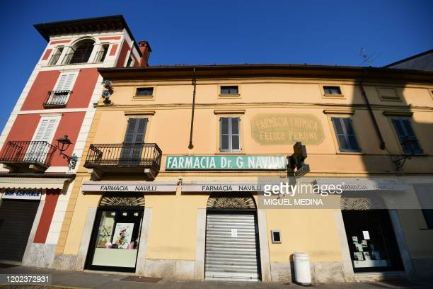 A closed pharmacy is pictured in Codogno southeast of Milan on February 22 2020 An Italian man became the first European to die after being infected...