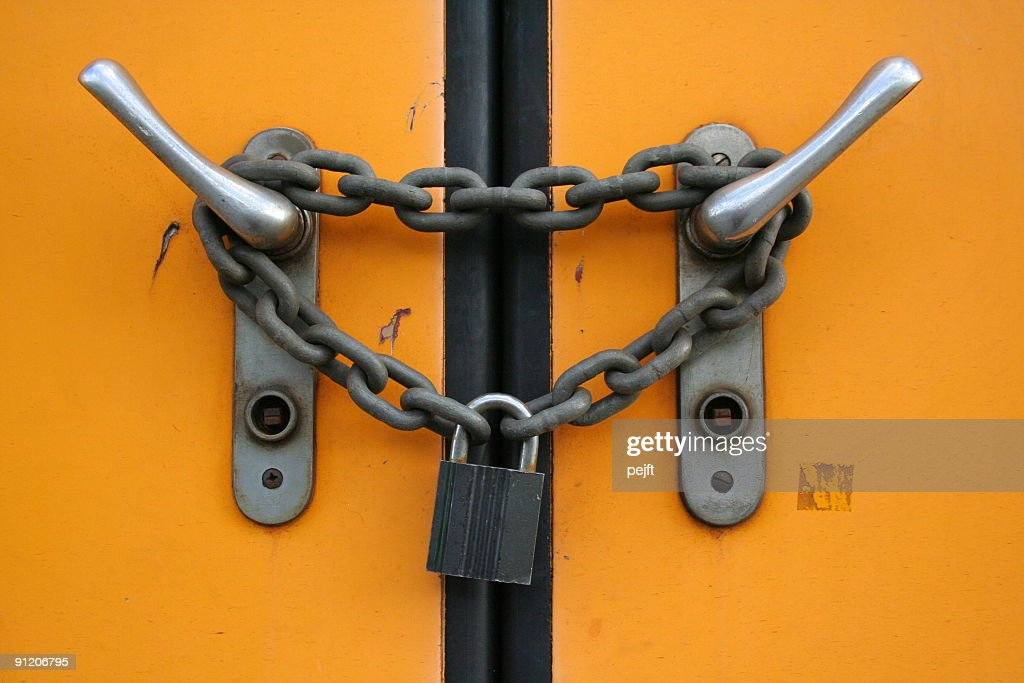 Closed plus locked with chain and padlock : Stock Photo