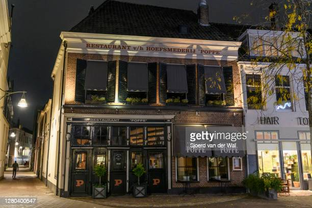 Closed Poppe Restaurant in the city center of Zwolle during the weekly shopping evening after the Dutch government announced new measures including...