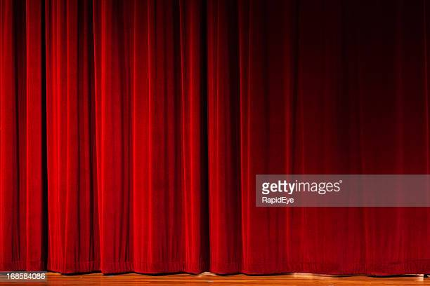 closed red curtains over theater stage - stage curtain stock pictures, royalty-free photos & images