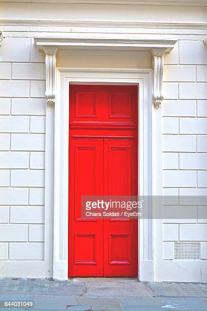 Closed Red Door Of House