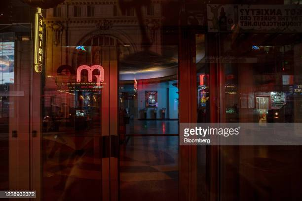 Closed Regal Cinemas movie theater stands at Night on 42nd Street in New York, U.S., on Tuesday, Oct. 6, 2020. More than 7,000 movie screens will be...