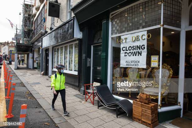 Closed restaurant and an antiques shop holding a closing down sale are pictured on 3rd November 2020 in Windsor, United Kingdom. Struggling...