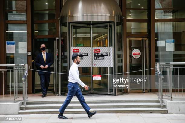 Closed revolving doors at an office building in the City of London, U.K., on Thursday, July 15, 2021. On Monday, Englands white-collar workers will...