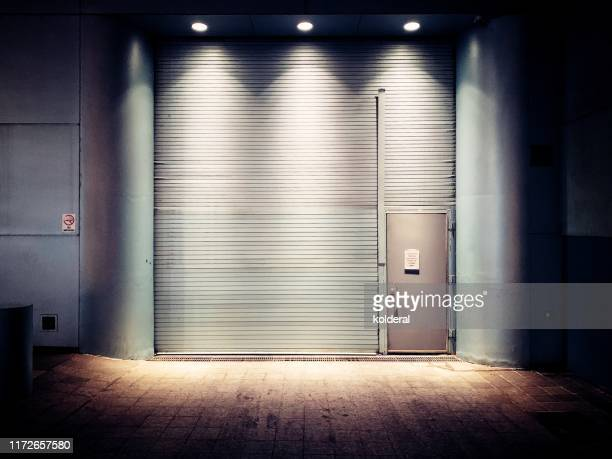 closed rolling doors - industrial door stock pictures, royalty-free photos & images