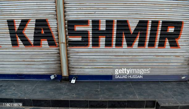 A closed shop is pictured during curfew in Srinagar on August 7 2019 A protester died after being chased by police during a curfew in Kashmir's main...