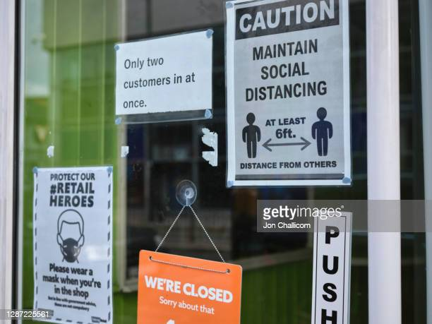 closed shop on a north london high street displaying their covid-19 signs - lockdown stock pictures, royalty-free photos & images