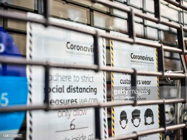 closed shop on a north london high street displaying their covid-19 signs - coronavirus photos stock pictures, royalty-free photos & images