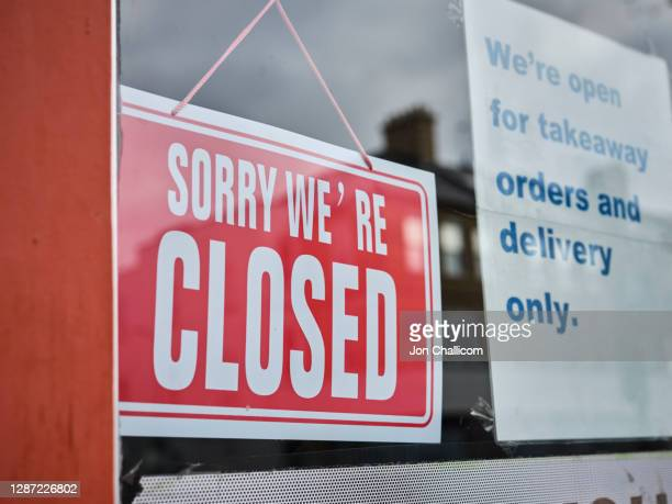 closed shop on a north london high street displaying their covid-19 signs - shop stock pictures, royalty-free photos & images