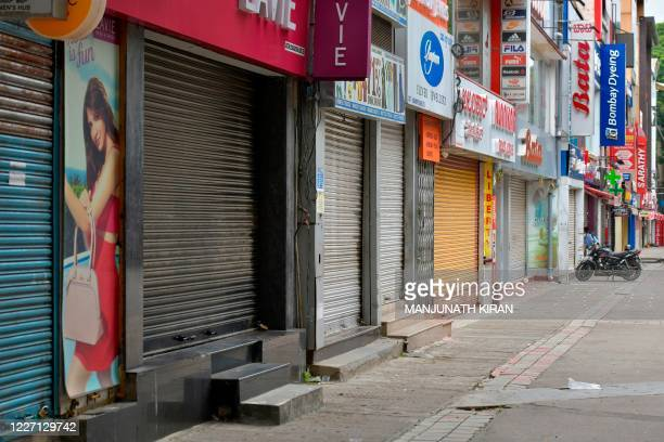 Closed shops are pictured in a commercial area during a week-long lockdown to contain the surge of COVID-19 coronavirus cases, in Bangalore on July...