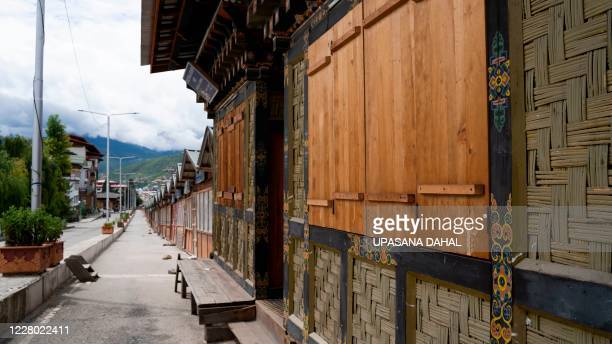 Closed shops are seen along a deserted road during a government imposed nationwide lockdown as a preventive measure against the COVID-19 coronavirus,...