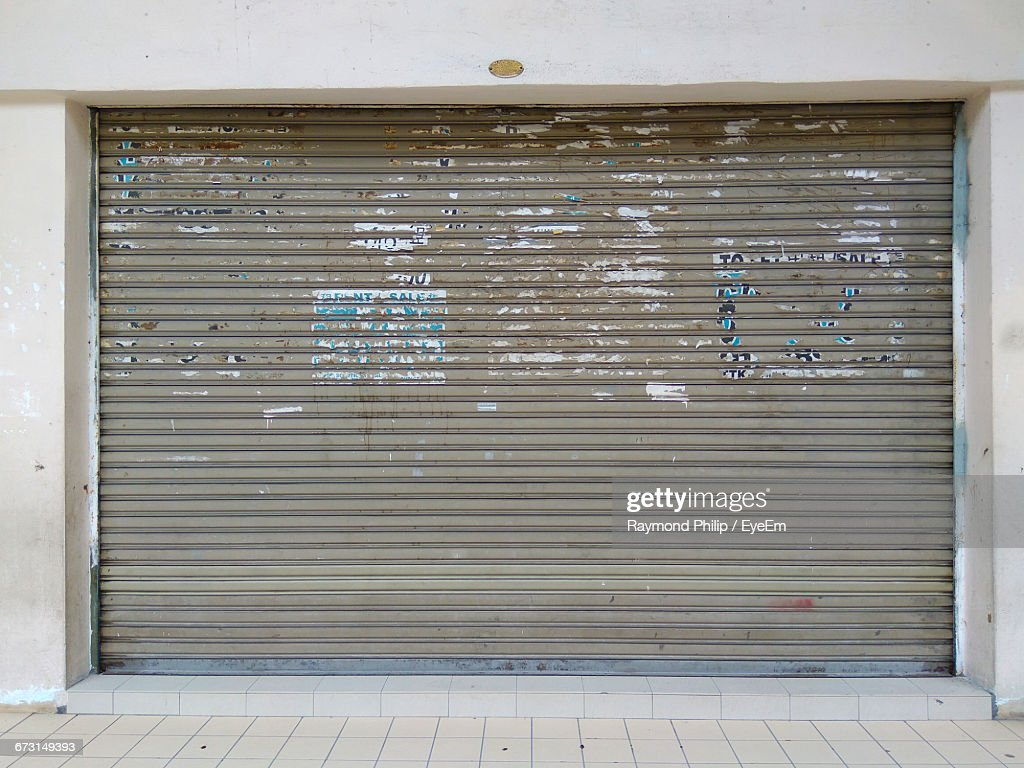 Closed Shutter Of Shop : Stock Photo