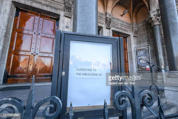 Closed sign at the entrance of the Basilica of Saint Nicholas church in Amsterdam during a weekday morning following the advice of the Dutch...