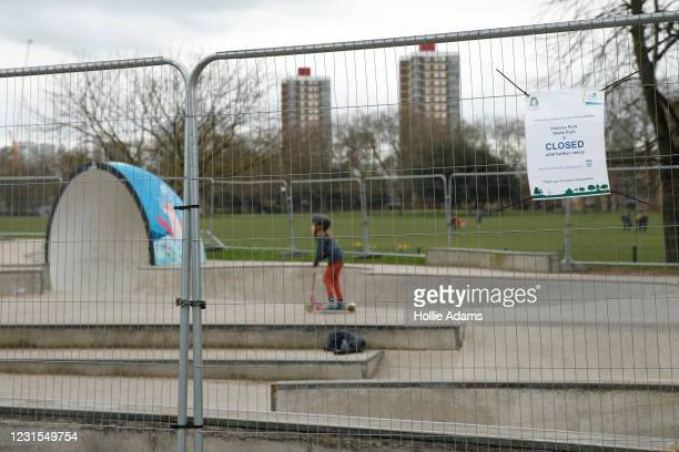 Closed sign attached to a fence surrounding the Victoria Park skatepark on March 6, 2021 in London, England. Londoners are enjoying bright weather as...