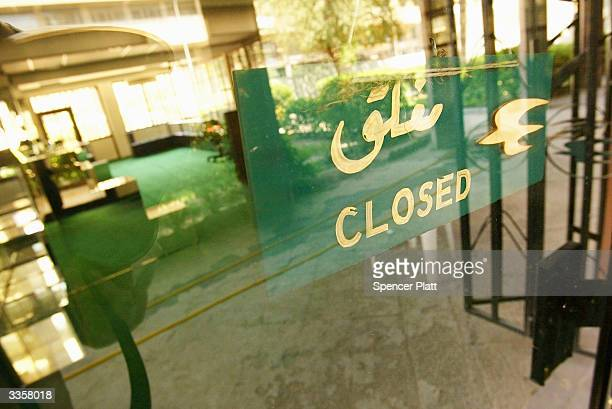 A closed sign hangs in the window of the offices for Iraqi Airways on April 14 2004 in Baghdad Iraq Kidnappings bombings and threats against foreign...