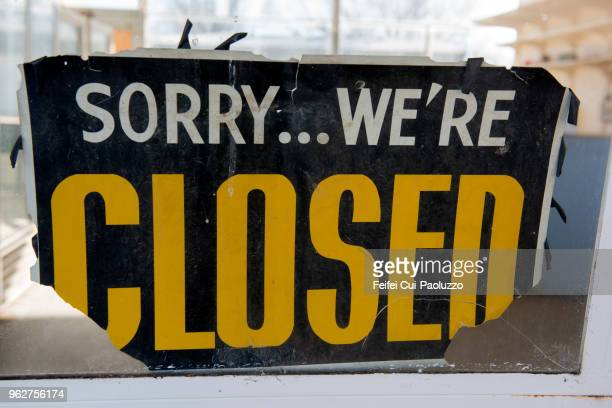 closed sign in a store window at springer, new mexico, usa - business closing stock photos and pictures
