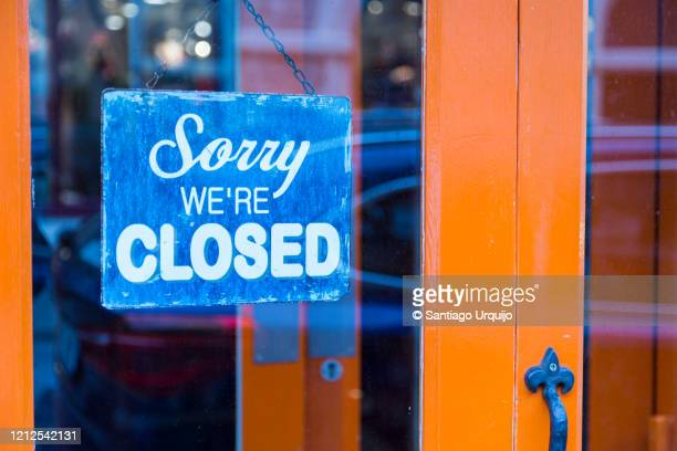 closed sign in shop door - closed stock pictures, royalty-free photos & images