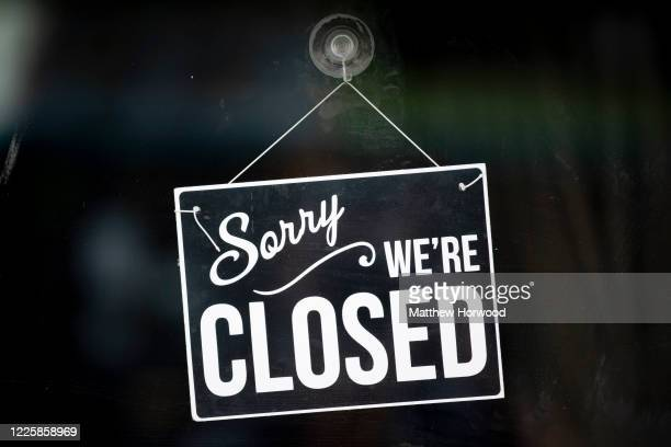 Closed sign in the window of a small business on May 19, 2020 in Cardiff, United Kingdom. The British government has started easing the lockdown it...