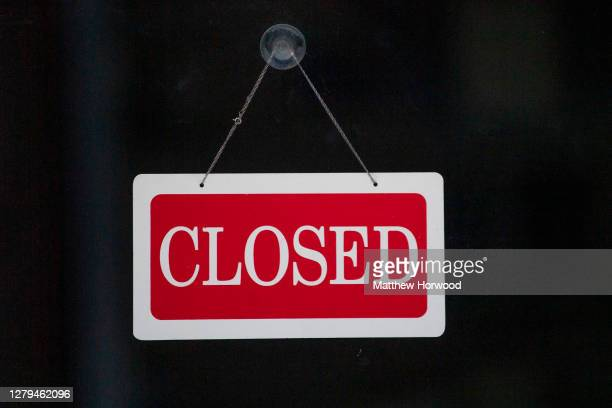 Closed sign in the window of a small business on September 25, 2020 in Cardiff, Wales. Many UK businesses are announcing job losses due to the...