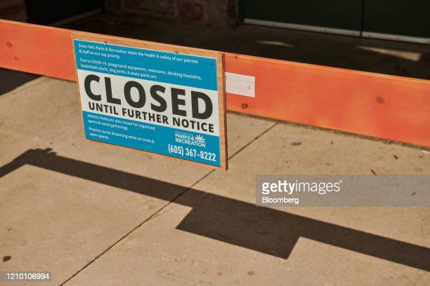 A Closed sign is displayed at Falls Park in Sioux Falls South Dakota US on Wednesday April 15 2020 South Dakota Governor Kristi Noem has argued that...