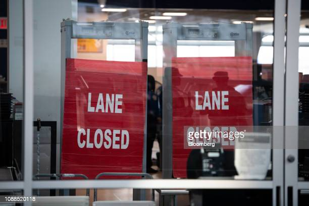 A Closed sign is displayed outside a Transportation Security Administration checkpoint lane at Terminal C in LaGuardia Airport in the Queens borough...