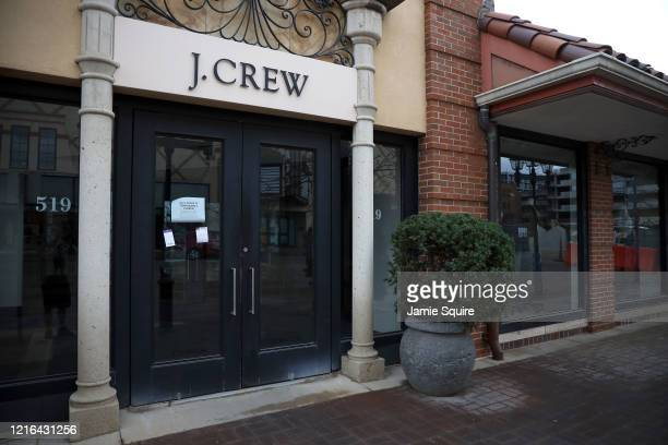 A closed sign is seen in the entrance of the J Crew store at Country Club Plaza as the Coronavirus Pandemic causes a climate of anxiety and changing...