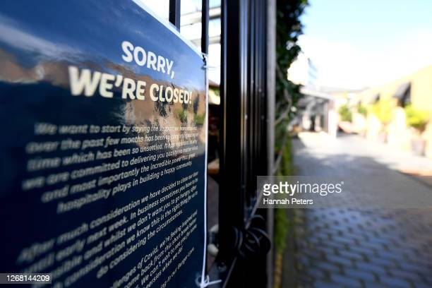 Closed sign is seen on a shop which remains closed at Level 3 on August 24, 2020 in Auckland, New Zealand. Prime Minister Jacinda Ardern announced an...
