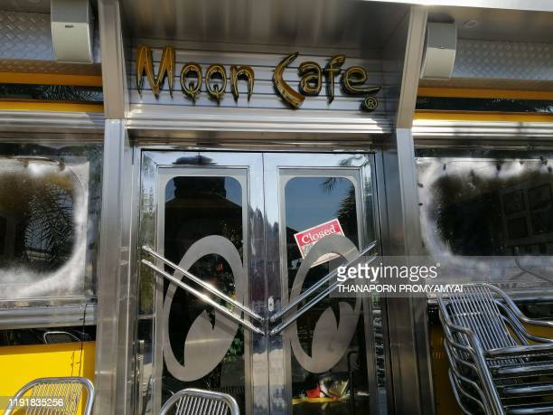 A closed sign is seen on the door of the popular MQQN retro cafe in Bangkok on January 5 2020 A Bangkok cafe drew the wrath of thousands of fans of...