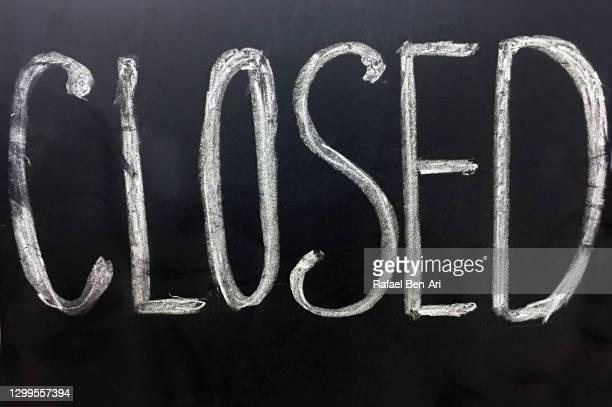 closed sign on a black background - rafael ben ari bildbanksfoton och bilder