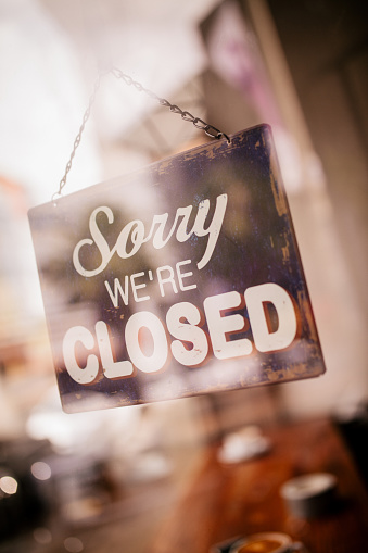 Closed Sign on Glass Door of Coffee Shop 518205136